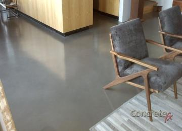 carmel acid stained concrete floor with ebony stencil